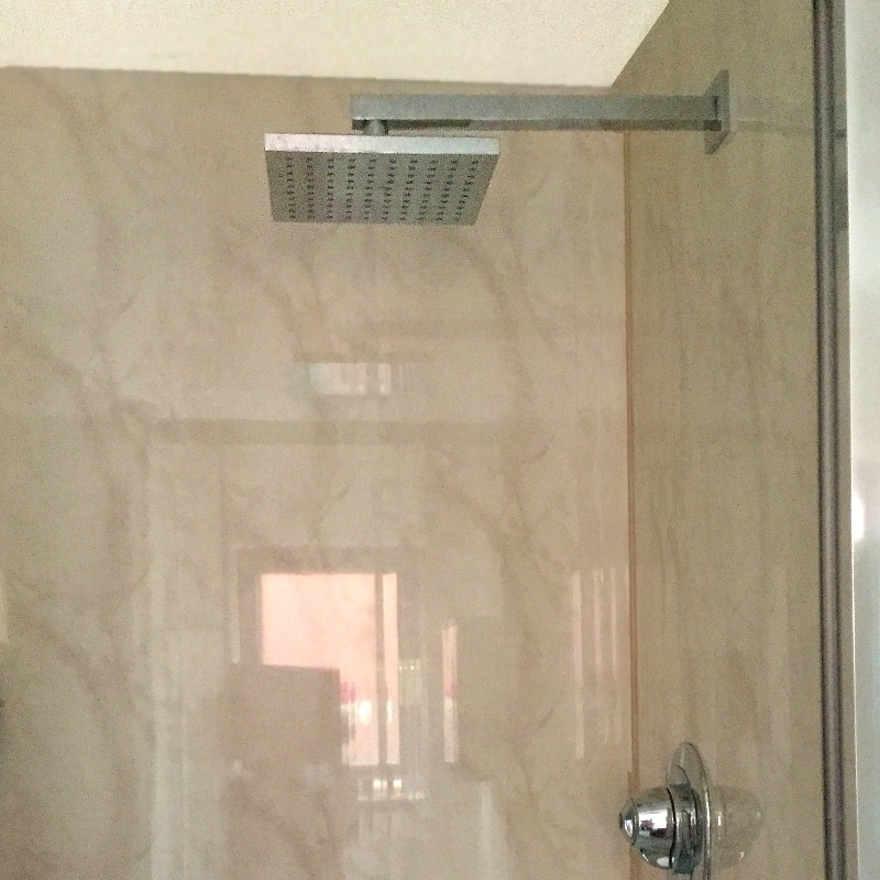 Vicenza beige bathroom cladding in a shower cubicle