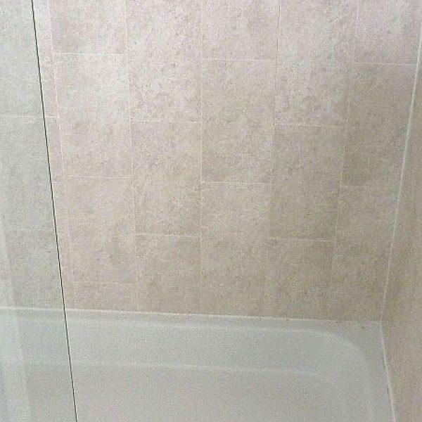 florentine beige tile effect panels in a shower