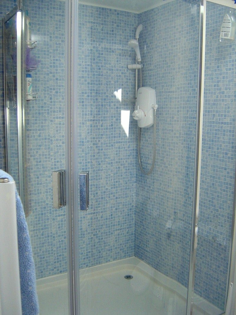 shower panels in a quadrant cubicle