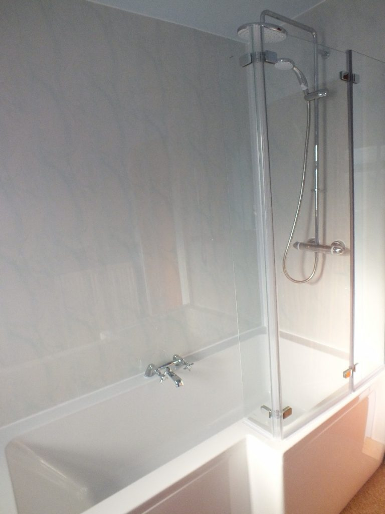 cladding around a shower bath the bathroom marquee. Black Bedroom Furniture Sets. Home Design Ideas
