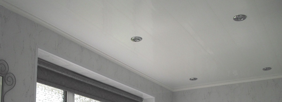 white panels fitted to bathroom ceiling